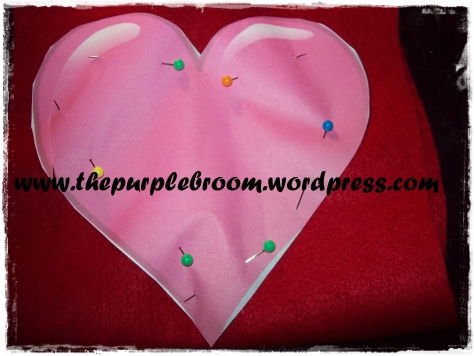 Heart template pinned onto red felt